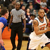 HADLEY GREEN/ Staff photo <br /> Salem's Marcus Faison moves the ball while Worcester's Corey Gatta (11) plays defense at the Salem State v. Worcester State MASCAC Tournament Championship game held at the Twohig Gymnasium at Salem State on Saturday, February 25, 2017.