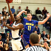HADLEY GREEN/ Staff photo <br /> Salem's Shaquan Murray (11) shoots while Worcester's Corey Gatta (11) plays defense at the Salem State v. Worcester State MASCAC Tournament Championship game held at the Twohig Gymnasium at Salem State on Saturday, February 25, 2017.