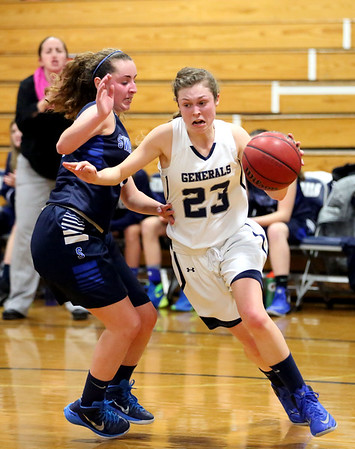 HADLEY GREEN/ Staff photo <br /> Hamilton-Wenham's Cecily Szady (23) dribbles while being guarded by Swampscott's Maggie DiGrande (23) at the Hamilton-Wenham v. Swampscott MIAA State Tournament first round playoff game at Hamilton-Wenham High School on Tuesday, February 28th, 2017.