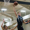 SAM GORESH/Staff photo. Pingree School's Kole Lentini gies up for a basket in their game against Concord Academy at the Pingree School. Pingree won the game 68-19. 2/3/17