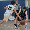SAM GORESH/Staff photo. Pingree School's Felix Kloxman passes the ball past Concord Academy's Reza Eshghi in their game at the Pingree School. Pingree won the game 68-19. 2/3/17