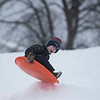 SAM GORESH/Staff photo. Bennett Carrarini, 6, gets some air while sledding at Lyons Park. 2/12/17