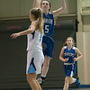SAM GORESH/Staff photo. Danvers junior Siobhan Moriarty shoots the ball as Peabody senior Katie Wallace attest to block her on defense in their game at Peabody High School. 2/3/17
