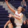 Ken Yuszkus/Staff photo: Salem: Salem's Rachel Carter sends one flying for the net during the Fitchburg State at Salem State women's basketball game.