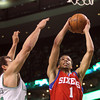 Boston: Philadelphia 76ers rookie guard Michael Carter-Williams (1) tries to dunk on Boston Celtics forward Kris Humphries (43) during the first half of play on Wednesday evening. DAVID LE/Staff Photo 1/29/14