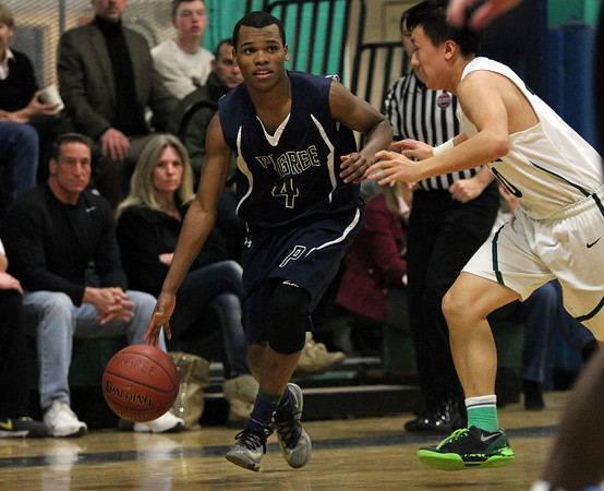 South Hamilton: Pingree senior captain Johnnie Spears (4) drives past Concord Academy defender Ahn Philip (10) on Friday evening. DAVID LE/Staff Photo 1/31/14
