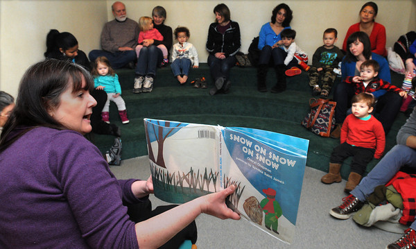 "Ken Yuszkus/Staff photo: Beverly: Children's librarian Margie McClory-Bonefant reads ""Snow On Snow On Snow"" during story hour for toddlers at the Beverly Public Library on Tuesday morning."