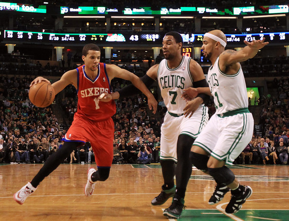 Boston: Hamilton native and Philadelphia 76ers rookie Michael Carter-Williams (1) tries to drive past Boston Celtics forward Jared Sullinger (7) and guard Jerryd Bayless (11) during the first half of play at the TD Garden. DAVID LE/Staff Photo 1/29/14