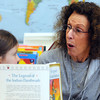 Ken Yuszkus/Staff photo: Salem:  Volunteer Susan Ableson, right, helps 1st grader Kate Heppner wih her reading at the Saltonstall School.