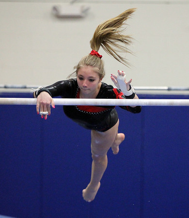 Beverly: Masco gymnast Caitlin Clarizia twists herself around in midair while performing on the uneven bars during a meet against Beverly at the Sterling Center YMCA on Friday evening. DAVID LE/Staff Photo 1/31/14