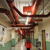 Ken Yuszkus/Staff photo: Salem: A student walks down the 3rd floor hallway where the newly renovated duct work is evident in the ceiling at the Collins Middle School.