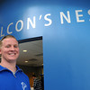 Ken Yuszkus/Staff photo: Danvers: Danvers High School senior Joe Poirier stands outside the Falcon's Nest which is a student run store at the school.