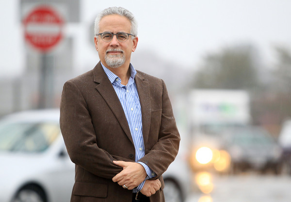 BEVERLY: Steven Cohen, President of CEA Group, the developer of a proposed shopping plaza on Brimbal Avenue, stands at the corner of Brimbal Ave and the 128 on/off ramp on Tuesday afternoon. DAVID LE/Staff Photo