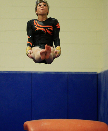 Marblehead: Beverly junior gymnast Heather Gomes flips over backwards after launching off the vault during a meeting between the Magicians and Panthers in an NEC gymnastics clash at the Lynch/van Otterloo YMCA on Wednesday evening. DAVID LE/Staff Photo 1/8/14