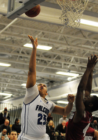 PAUL BILODEAU/Staff photo<br /> <br /> Danvers High School basketball player Devan Harris drives for two points during the Falcons' game against Lynn English in Danvers.