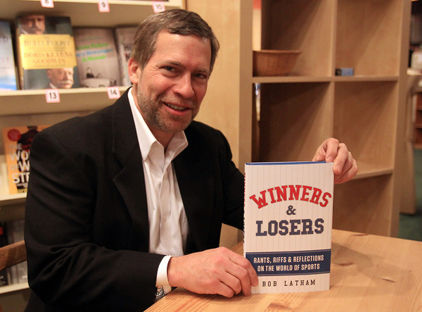 "Marblehead: Sports lawyer Bob Latham holds a copy of his book, ""Winners & Losers"" at the Spirit of '76 Bookstore in Marblehad on Thursday evening. In addition to a book signing on Thursday, Latham will be speaking at a fundraiser for Northeastern Sports Fund and Skillz Academy Friday evening starting at 6:30pm at The Landing in Marblehead. DAVID LE/Staff Photo"