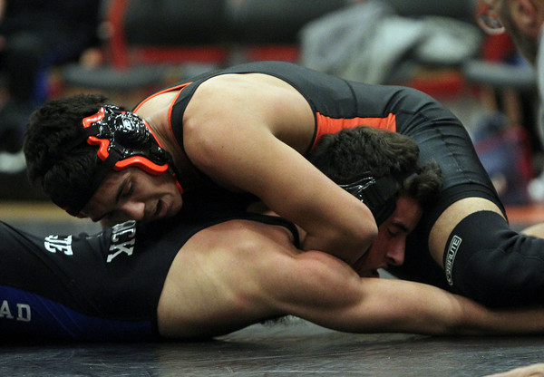 Beverly: Beverly's Alberto Oyla, right, holds Marblehead's David Bolognese in a headlock during their 152-lb match on Thursday evening. DAVID LE/Staff Photo