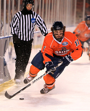 Boston: Salem State sophomore forward Chris Mastropietro (17) carries the puck up the boards during the Vikings Frozen Fenway game against UMass Boston on Tuesday afternoon. The Vikings fell to the Beacons 4-2. DAVID LE/Staff Photo