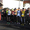 Ken Yuszkus/Staff photo: Salem: Co-director of the race Tim Short lines up the runners for the start of the seventh annual Frosty Four 4-mile road race in Salem.