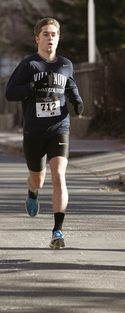 Ken Yuszkus/Staff photo: Salem: Jordan Williamsz of Australia is the first to cross the finish line at the seventh annual Frosty Four 4-mile road race in Salem.