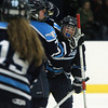 Peabody: Peabody forward Sophia Post, center, gets congratulated on her second period goal from line mate Alice Murphy, right, during a matchup between the Tanners and Lady Crusaders at McVann-O'Keefe Rink in Peabody. DAVID LE/Staff Photo 1/10/14