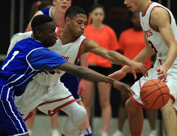 Salem: Danvers sophomore Rashad Francois (1) battles for a loose ball with Salem senior Shaky White (2) during the first half of play on Tuesday evening. Salem defeated Danvers 41-38 in a closely contested game on Tuesday evening. DAVID LE/Staff Photo 1/14/14