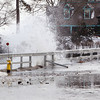 Marblehead: High tide waves crashed over the wall and onto Beacon Street near Peaches Point in Marblehead. DAVID LE/Staff Photo