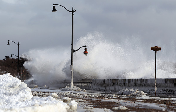 Marblehead: Waves crash over the wall of the causeway in Marblehead on Friday afternoon. DAVID LE/Staff Photo