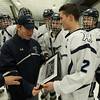 Peabody: Peabody captain Andrew Bisconti (2) presents head coach Mark Leonard with a plaque to commemorate his 200th victory following a 5-3 over Lynn on Saturday evening. DAVID LE/Staff Photo