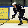 Salem: Swampscott freshman forward Mike Johnson (9) controls the puck along the wall on a Big Blue power play against Salem on Wednesday afternoon. The Witches defeated the Big Blue 3-1 at Rockett Arena at Salem State University in NEC action. DAVID LE/Staff Photo