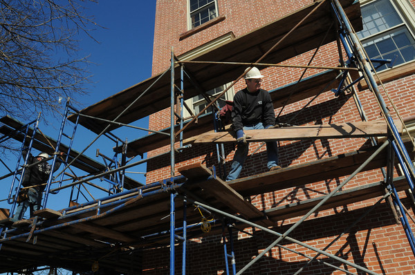Ken Yuszkus/Staff photo: Beverly:  Rich Doyle, left, and Kendall Oeahley take down the scaffolding along the south side of Beverly City Hall Wednesday morning.