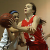Lynnfield: Masco junior guard Meghan Collins (5) gets fouled by Lynnfield junior Tonianna DiCesare (22) while driving to the hoop during the Chieftans 53-45 win over the Pioneers in a matchup between the top two teams in the Cape Ann League on Friday evening. DAVID LE/Staff Photo