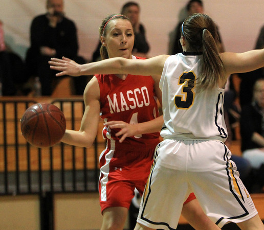 Lynnfield: Masco senior captain Nicole Femino (4) makes a pass past the outstretched arms of Lynnfield senior Ashley McRae (3) during the Chieftans 53-45 win over the Pioneers in a matchup between the top two teams in the Cape Ann League on Friday evening. DAVID LE/Staff Photo