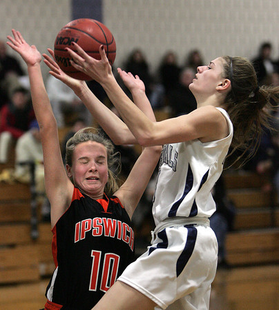 Ken Yuszkus/Staff photo: Hamilton:  Hamilton-Wenham's Tori Vivenzio goes up for a shot as Ipswich's Jackie Gagnon blocks during the Ipswich at Hamilton-Wenham girls basketball game.