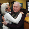 Executive assistant to the chief of police Helen Paouzzi hugs Beverly Mayor Bill Scanlon during the farewell reception held at the Beverly City Hall City Council Chambers on Thursday.