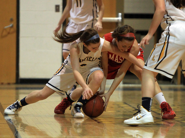 Lynnfield: Masco junior Amy Fogarty (21) battles for a loose ball with Lynnfield senior Ashley McRae (3) during the Chieftans 53-45 win over the Pioneers in a matchup between the top two teams in the Cape Ann League on Friday evening. DAVID LE/Staff Photo