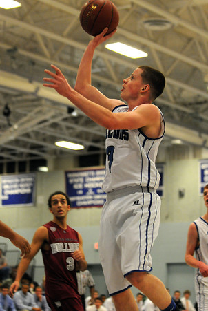 PAUL BILODEAU/Staff photo<br /> <br /> Danvers High School basketball player Mark McCarthy drives for two points during the Falcons' game against Lynn English in Danvers.