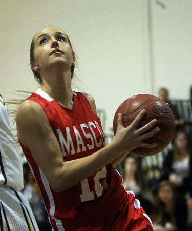 Lynnfield: Masco senior captain Hannah Kiernan (12) drives strong the hoop against Lynnfield during the Chieftans win over the Pioneers in a matchup between the top two teams in the Cape Ann League on Friday evening. DAVID LE/Staff Photo