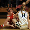 Lynnfield: Masco senior captain Lexie Nason (24) dives on the floor and battles with Lynnfield junior Emma Mancini (11), creating a jump ball and Lynnfield turnover during the Chieftans 53-45 win over the Pioneers in a matchup between the top two teams in the Cape Ann League on Friday evening. DAVID LE/Staff Photo