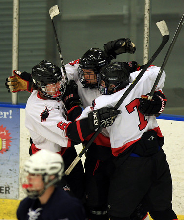 Salem: Salem junior forward Sam Petri (14), center, celebrates his second period goal with teammates Eli Spector (6) and senior Danny Heck (7) on Wednesday afternoon. The Witches defeated the Big Blue 3-1 at Rockett Arena at Salem State University in NEC action. DAVID LE/Staff Photo