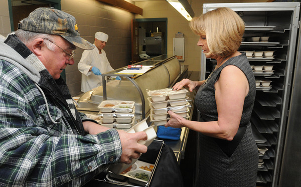 Ken Yuszkus/Staff photo: Peabody: Meals On Wheels co-ordinator Sandra Cloutman and driver John Tetrault pack meals at the Torigan Center which will be delivered to elderly Peabody residents.