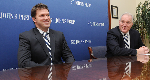 Ken Yuszkus/Staff photo: St. John's Prep's new football coach Brian St. Pierre, left, speaks while former coach Jim O'Leary is at his side at a press conference to announce the new coach at the school.