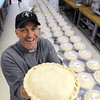 Ken Yuszkus/Staff photo: Salem: Ken's Kickin Chicken founder Ken Rothwell holds one of his chicken pot pies.