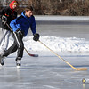 Ken Yuszkus/Staff photo: Beverly: Max Gansenberg, left, and Matthew Bourque pass a puck around while ice skating on Kellehers Pond in Beverly.