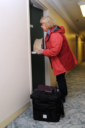 Ken Yuszkus/Staff photo: Peabody: Meals On Wheels driver Christine Phillips delivers meals to elderly Peabody residents.