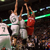 Boston: Hamilton native Michael Carter-Williams (1) lets go of a floater while being fouled by Boston Celtics guard Jerryd Bayless (11) as Boston forward Kris Humphries leaps up for the block. DAVID LE/Staff Photo 1/29/14
