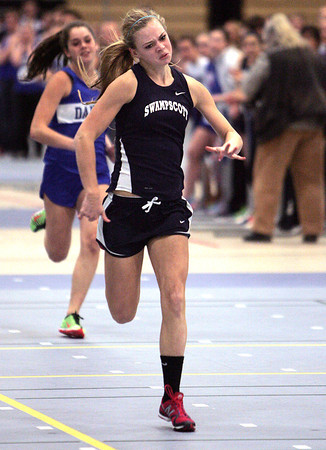 Ken Yuszkus/Staff photo: Danvers: Swampscott's Mackenzie Faulkner wins her heat in the 55 meter dash during the Swampscott at Danvers indoor track meet.
