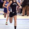 Ken Yuszkus/Staff photo: Danvers: Swampscott's Mackenzie Faulkner wins her heat in the 55 meter dash during the Swampscott at Danvers indoor track meet.