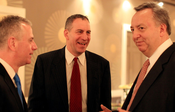Danvers: State Representative Jerry Parisella, center, talks with Hank Laughton, left, and Anthony Miranda, right, at the Mayor's Inaugural Ball for new Beverly Mayor Mike Cahill, held at the Danversport Yacht Club on Saturday evening. DAVID LE/Staff Photo