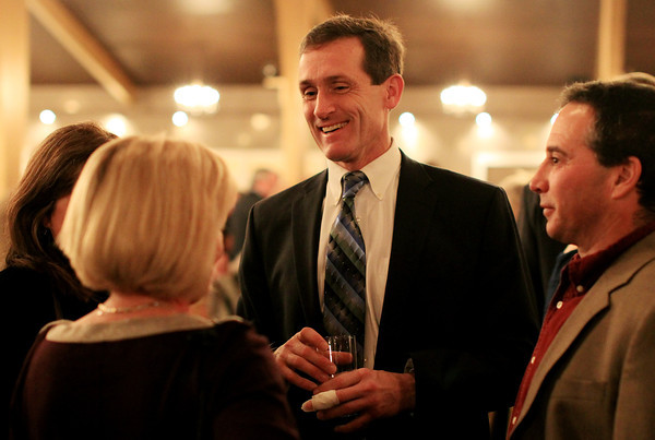 Danvers: Beverly Mayor Mike Cahill talks with Eileen and Brian Boches, during the Mayor's Inaugural Ball held at the Danversport Yacht Club on Saturday evening. DAVID LE/Staff Photo